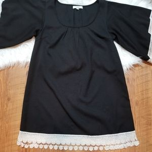 Umgee black dress with embroidery white flower hem
